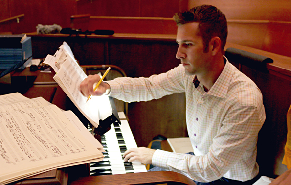 Flint Dollar practices organ at First Presbyterian Church in Milledgeville, Ga. He's working there part time while he pursues a legal complaint against a private Catholic school that declined to renew his position after administrators learned he plans to marry his male partner.