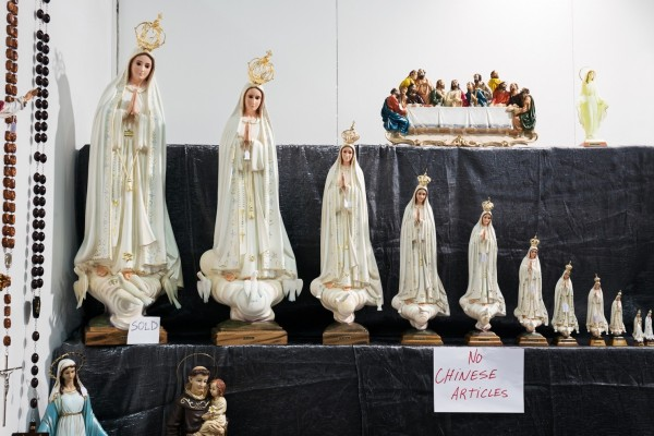 """Madonnas."" Madonna statues ordered by size."