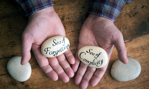 Joe with the stones he has inscribed with messages to the archbishop of Canterbury.