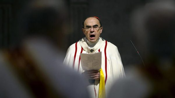 French Cardinal Philippe Barbarin, Archbishop of Lyon, leads a mass for migrants in the Saint-Jean Cathedral, in Lyon, central France, Sunday, April 3, 2016.