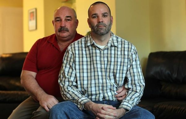 Matthew Barrett (right) says his job offer at Fontbonne Academy in Milton, Massachusetts, was rescinded when he listed his husband as an emergency contact.