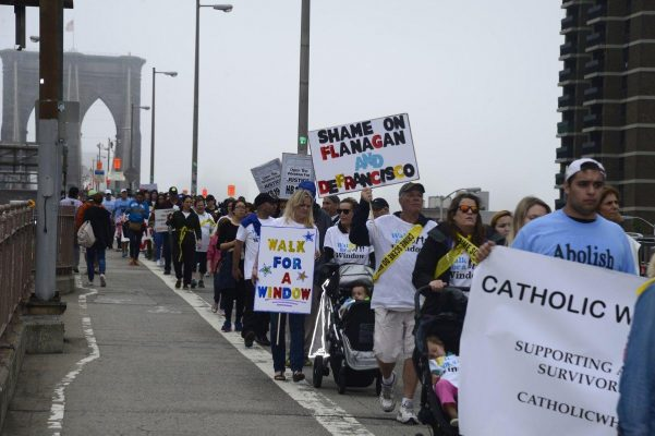 Advocates for children marched across Brooklyn Bridge to urge pols to change the state's kid-rape law.
