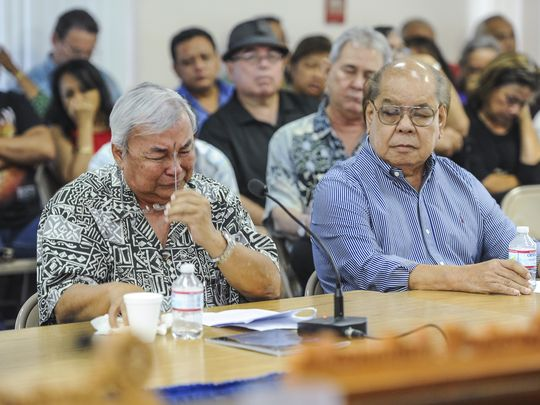 Leo Tudela, 73, pulls off his eyeglasses as he is overcome with emotions during his testimony in support of Bill 326 at the Guam Legislature in Hagatna on Monday, Aug. 1. Tudela testified that as a child, he served as an altar boy with the Mount Carmel Church in Chalan Kanoa, Saipan until he was given the opportunity to attend Catholic school on Guam. Tudela told lawmakers during his testimony that he was sexually abused by three members of Guam's Catholic Church, including a priest, on three different occasions.