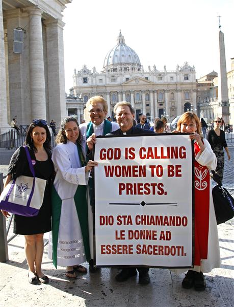 Father Roy Bougeois from Georgia poses with a group of Roman Catholic activist in front of the Vatican
