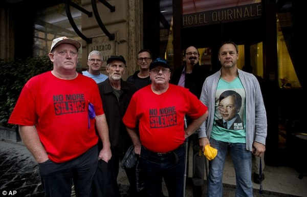 Survivors and family members of Risdale's victims - Dominic Ridsdale, Phil Nagle, Paul Auchettl, David Ridsdale, Tony Waroley, Stephen Woods and Peter Blenkiron - stand in front of the Quirinale hotel in Rome